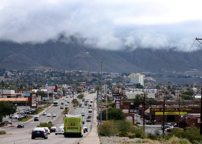 Clouds hover low over the Franklin Mountains on Wednesday following overnight rains in this view along North Mesa Street in West El Paso.