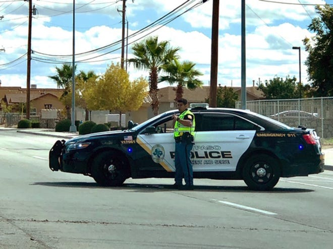 An El Paso police officer blocks the eastbound lanes of the 8600 block of North Loop Drive during a SWAT action there Wednesday.