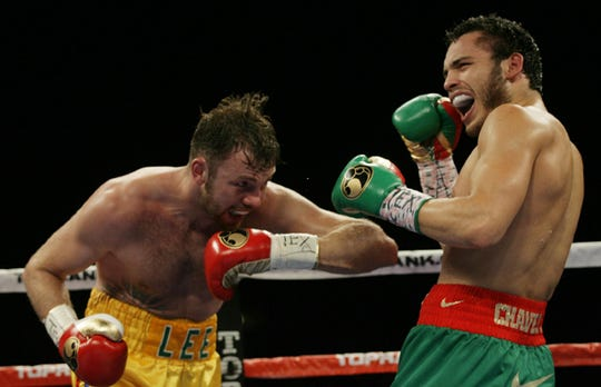 Julio Cesar Chavez reacts after Andy Lee head butted him during their WBC middleweight title bout Saturday June 16, 2012 in El Paso, Texas. Lee was warned by the referee.