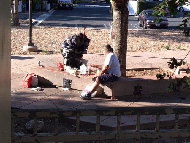 A lot next to a CVS in downtown Thousand Oaks is a spot where homeless people gather.