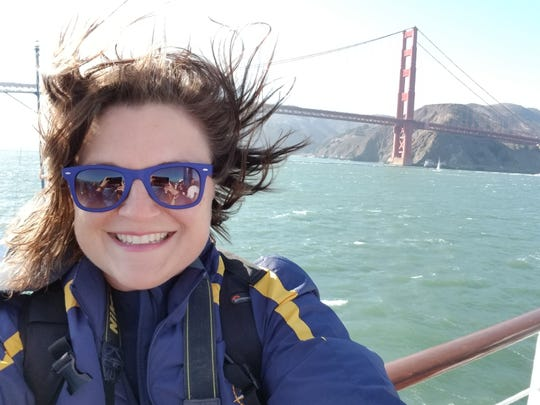 Melissa Baffa, a science communications fellow aboard the Exploration Vessel Nautilus, takes a selfie as the ship leaves San Francisco Bay. The Ventura resident is part of a team exploring the Monterey Bay National Marine Sanctuary.