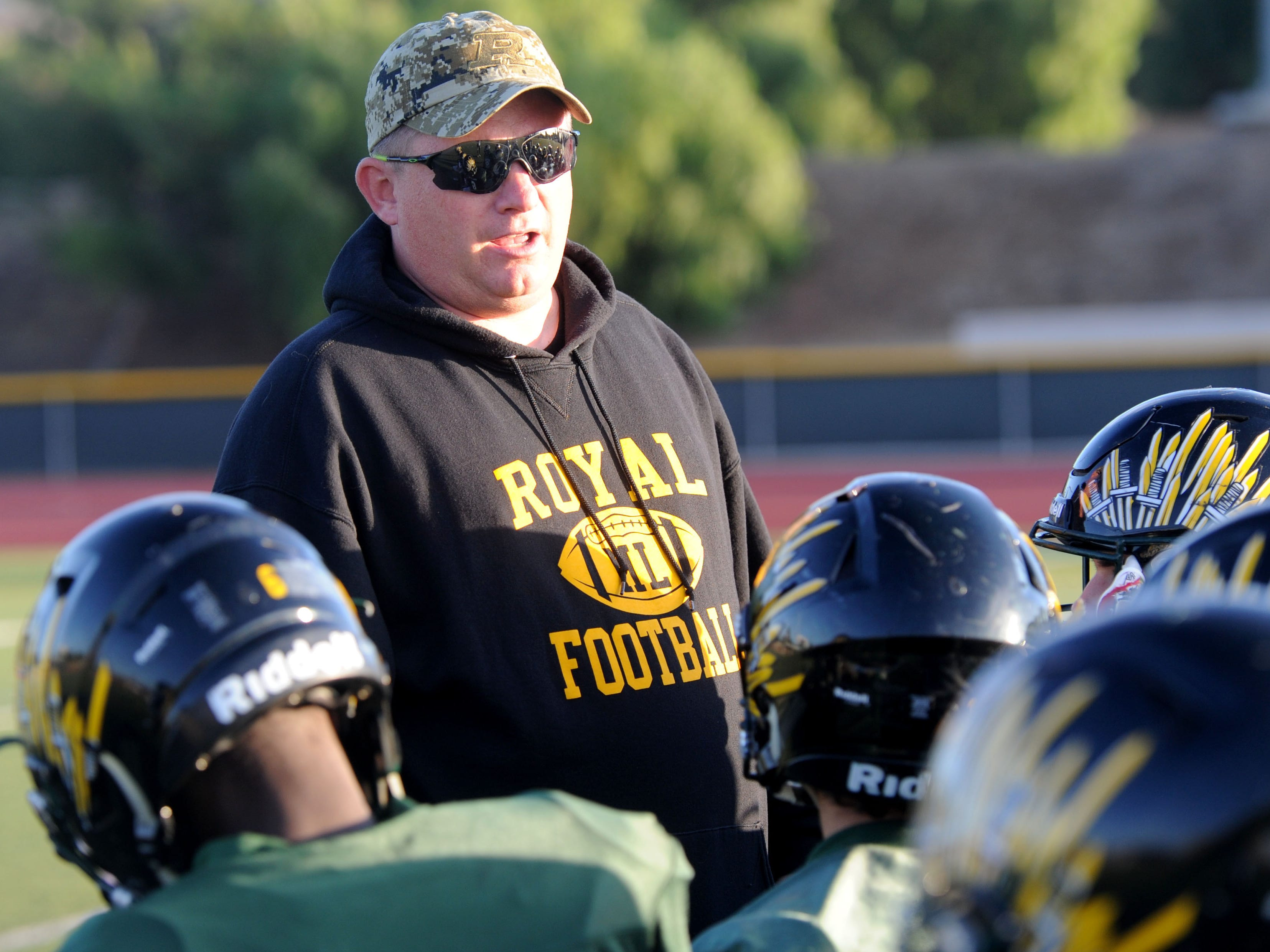 Royal High head football coach Matt Lewis says his firing the result of smear campaign