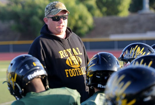Royal High head coach Matt Lewis gathers his team for a quick talk during Tuesday's practice.