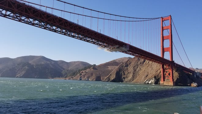 The crew aboard the Exploration Vessel Nautilus get an up-close view of the Golden Gate Bridge in San Francisco as they leave for their latest research trip.