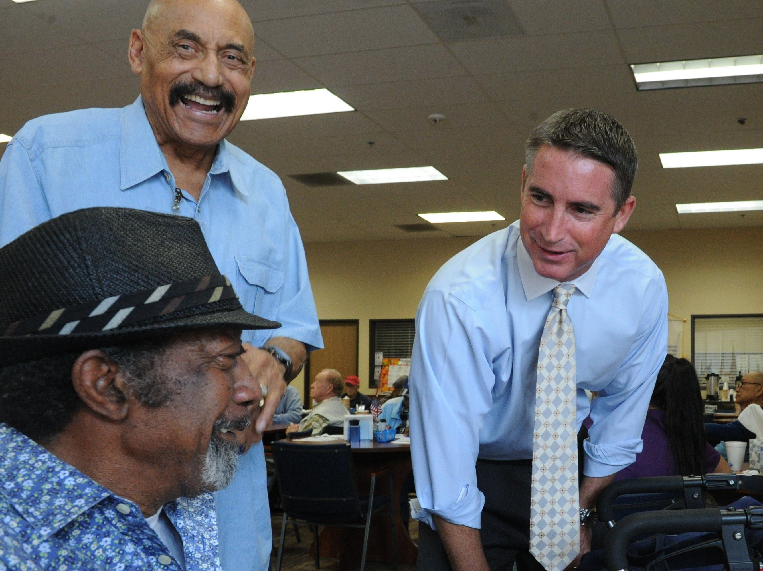 In 2014, former Assemblyman Jeff Gorell, right, was campaigning for Congress. Bedford Pinkard, standing left, is seen with Gorell greeting a veteran at the Adult Day Health Care Center in Oxnard.