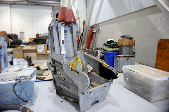 Historic military items, including this aircraft ejection seat, were on display before being auctioned off at the Millville Executive Airport on Wednesday, October 24, 2018.