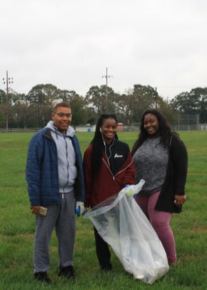 "(From left) Jayron Jamison, Oxana Gault and Lakendra Herring participated in Bridgeton High School's ""Give Back"" cleanup of Bridgeton City Park."