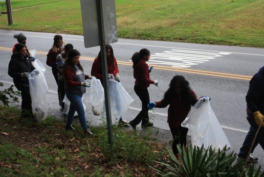 """Bridgeton City Park is quite a bit cleaner as a result of Bridgeton High School's """"Give Back"""" cleanup."""
