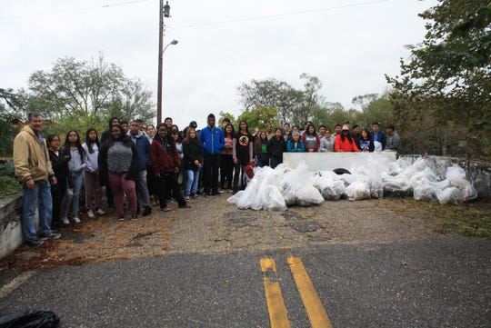 """Bridgeton High School's """"Give Back"""" cleanup of Bridgeton City Park resulted in more than 40 bags full of recyclables and trash, along with several tires, an old television, and countless other items being collected and removed from the park."""
