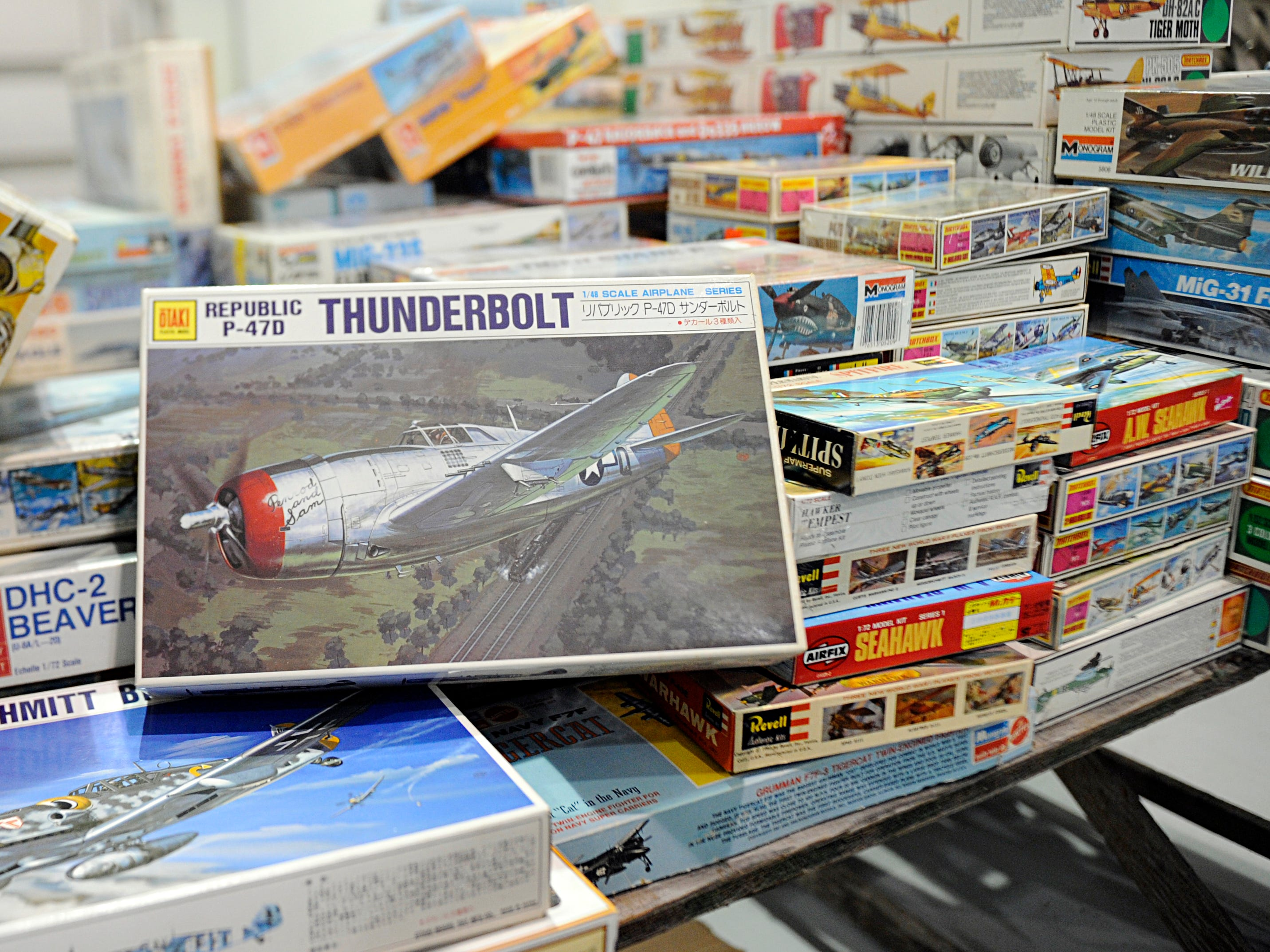 A table piled with vintage model plane kits are among the 1,500 military items being auctioned off at Millville Executive Airport.