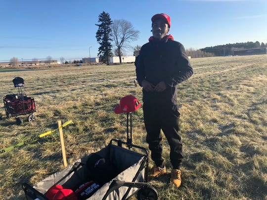 "Derovanti Richardson of Columbia, South Carolina was one of several people selling ""Make America Great Again"" hats to keep fans warm."