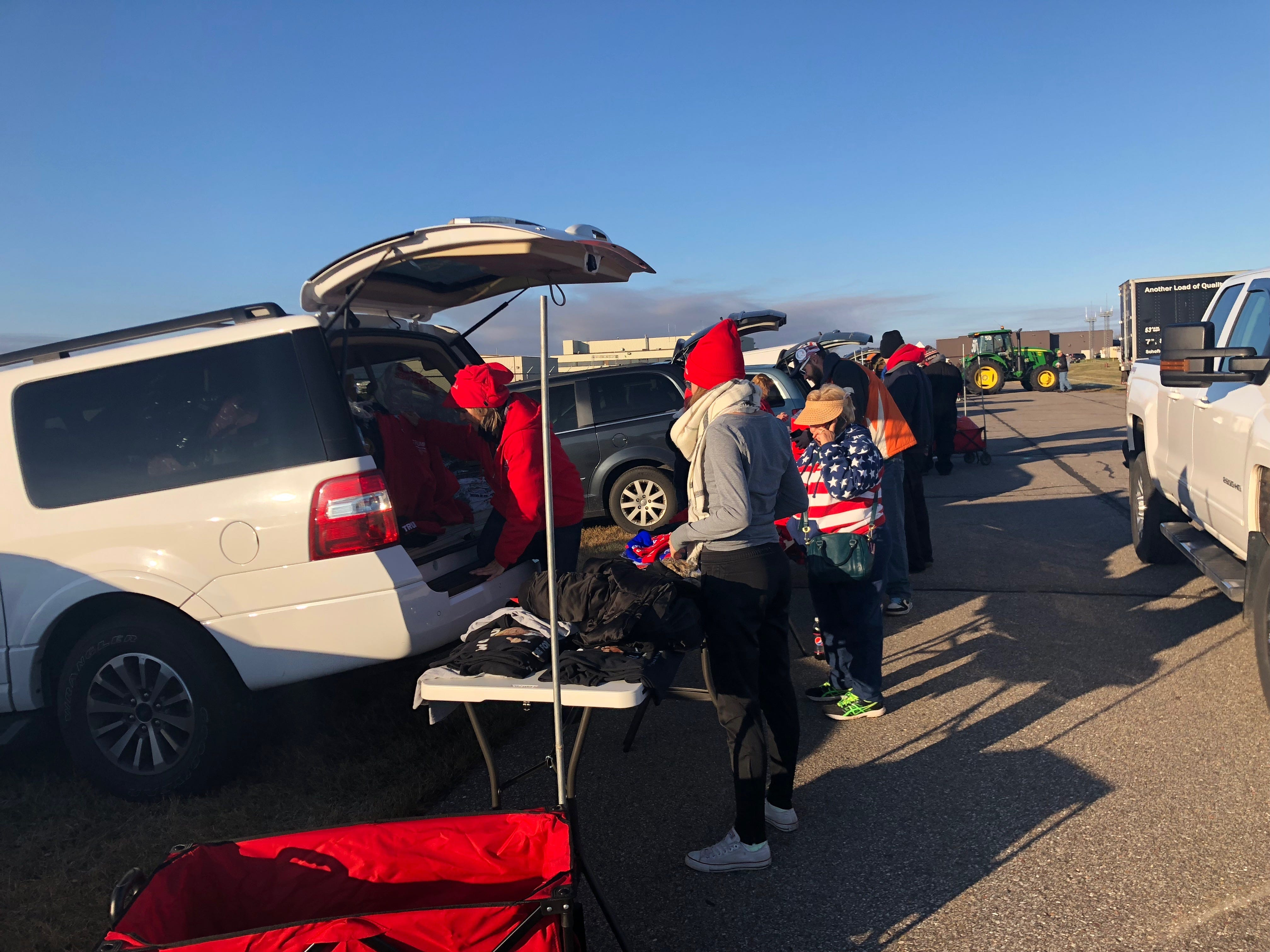 Vendors sent up Wednesday morning, filling their tables full of Donald Trump-themed clothing ahead of the evening rally at the Mosinee airport.