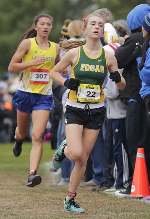 Edgar's Marissa Ellenbecker leads Lancaster's Lydia Murphy in the Division 3 girls race during the WIAA state cross country meet last year. Ellenbecker, the defending state champion, and Murphy have the top two qualifying times for Saturday's race.