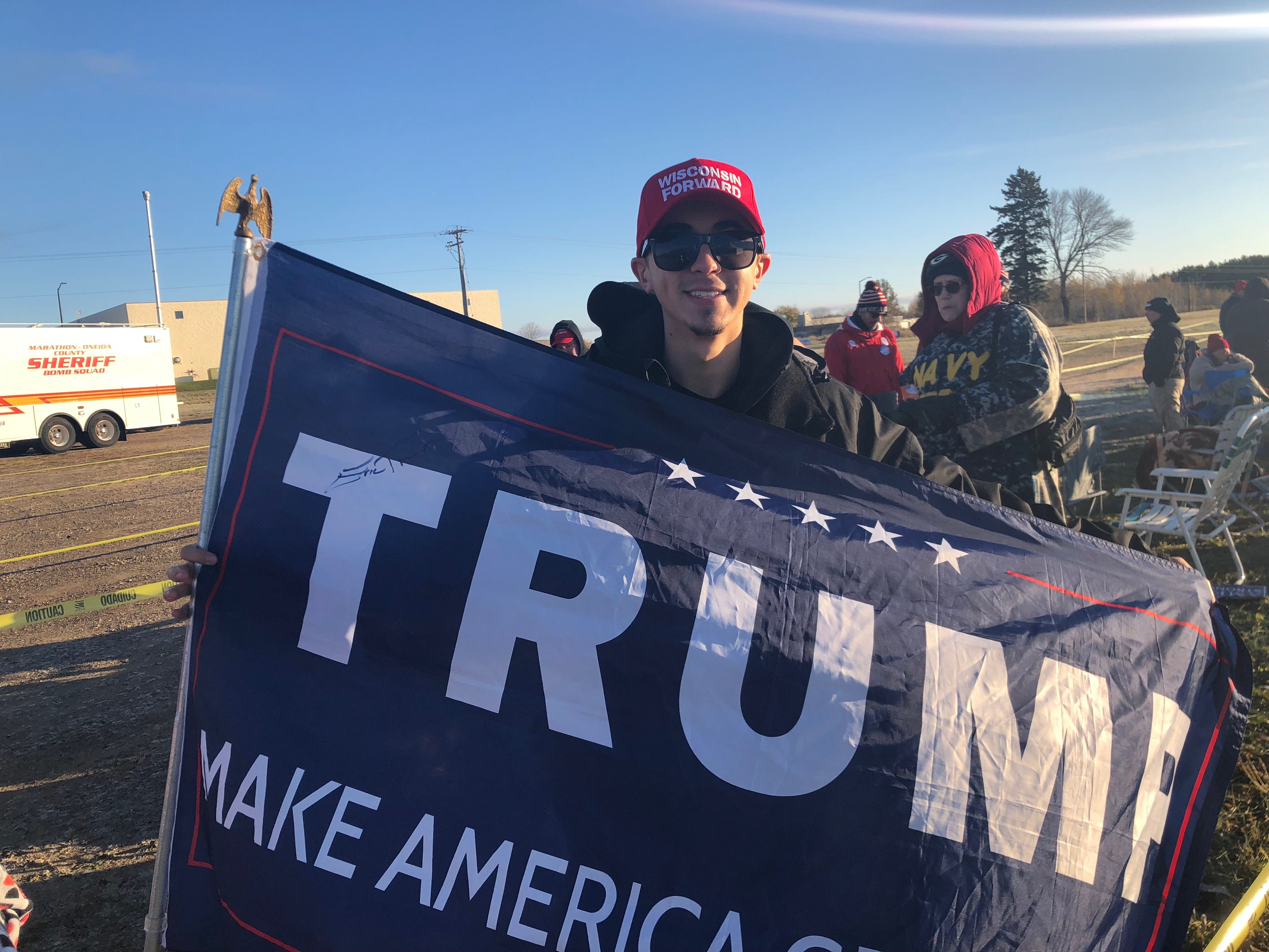 Chaz Fuller proudly displays a Trump flag, signed by the president's son, Eric Trump.