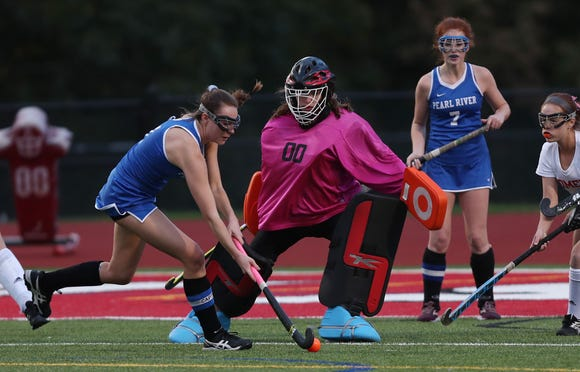 Pearl River's Breanne Dolphin (1) tries to get a shot past Somers goalie Carleigh Carbonaro  during girls field hockey playoff action at Somers High School Oct. 23, 2018. Pearl River won the game in penalty shots 2-1.