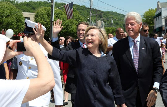 Hillary and Bill Clinton are seen marching in New Castle's Memorial Day Parade in Chappaqua.