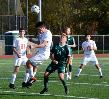 Somers center back Max Grell heads a long ball back upfield during the second half of Tuesday's Class A quarterfinal.