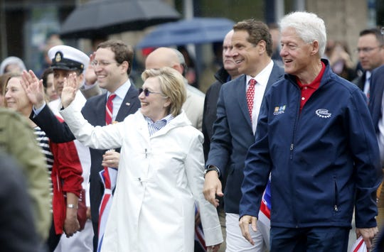 Former Secretary of State Hillary Clinton, Gov. Andrew Cuomo and former President Bill Clinton marched in the New Castle Memorial Day observance and parade in Chappaqua.