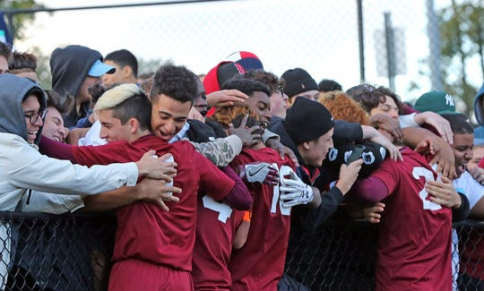 Ossining celebrates their 2-0 win over New Rochelle during the Class AA boys soccer semifinal game at Ossining High School onOct. 24, 2018.
