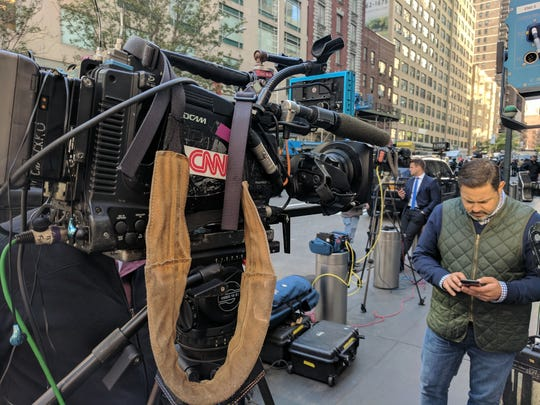 CNN sets up shop outside its offices after a bomb was discovered and offices were evacuated in New York City.