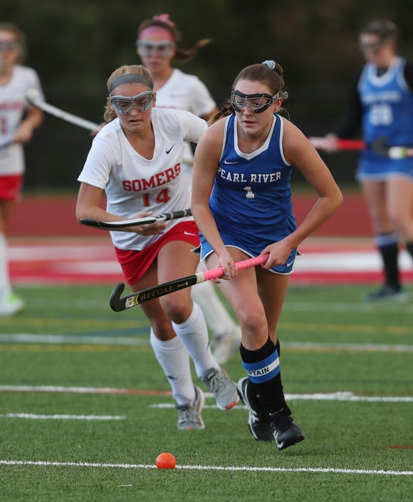Pearl River's Breanne Dolphin (1) moves the ball away from Somers' Erin Clark (14) during girls field hockey playoff action at Somers High School Oct. 23, 2018. Pearl River won the game in penalty shots 2-1.