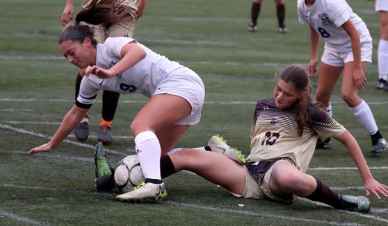 Same Colatruglio of Mahopac and Caroline Guarino of Clarkstown South battle during a Section 1 Class AA girls soccer quarterfinal at Clarkstown South High School Oct. 23, 2018. Clarkstown South defeated Mahopac 1-0.