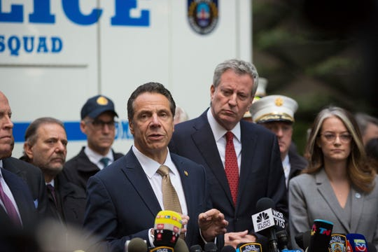 """Mayor Bill de Blasio looks on as Gov. Andrew Cuomo delivers remarks during a news conference after NYPD personnel removed an explosive device from Time Warner Center Wednesday, Oct. 24, 2018, in New York.  The U.S. Secret Service says agents have intercepted packages containing """"possible explosive devices"""" addressed to former President Barack Obama and Hillary Clinton.   (AP Photo/Kevin Hagen)."""