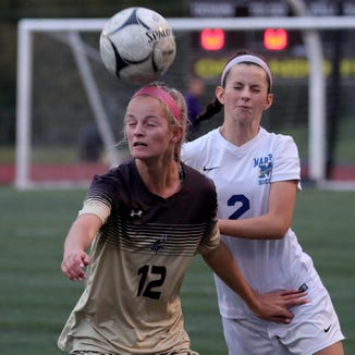 Caroline Kelly of Clarkstown South and Christina Lopreato of Mahopac battle during a Section 1 Class AA girls soccer quarterfinal at Clarkstown South High School Oct. 23, 2018. Clarkstown South defeated Mahopac 1-0.