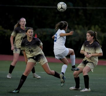 Hailey Pereira of Mahopac heads the ball over Clarkstown South defenders during a Section 1 Class AA girls soccer quarterfinal at Clarkstown South High School Oct. 23, 2018. Clarkstown South defeated Mahopac 1-0.