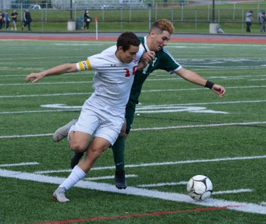 Somers forward Lucas Fecci and Yorktown midfielder Sergio Spiniello wrestle for a ball along the sideline Monday during the first half of the Tuskers' 2-0 win.