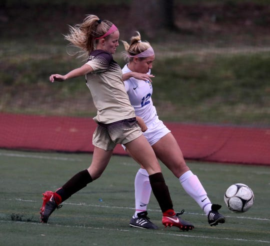 Clarkstown South's Caroline Kelly (left) attempts to gain possession of the ball.