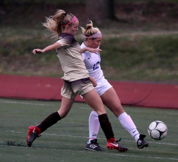 Clarkstown South's Caroline Kelly (left) in action during a game against Mahopac last year at Clarkstown South High School.