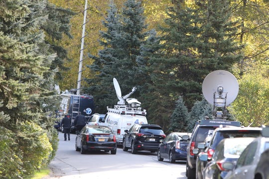 Media is gathered on the street outside Hillary and Bill Clinton's home in Chappaqua, New York, after an explosive device sent to Hillary Clinton was intercepted, Wednesday, Oct. 24, 2018.