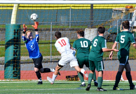 Yorktown goalie James D'Alessio chases down one of his 13 saves Monday during a Class A quarterfinal loss to Somers.