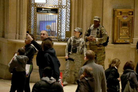 Members of the National Guard patrol Grand Central Terminal in Manhattan after suspicious packages were sent to former Secretary of State Hillary Clinton, former President Barack Obama as well as the New York City offices of CNN.