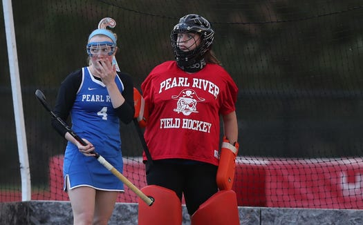 Pearl River goalie Alexys Warner (in red) during Oct. 23, 2018 playoff win against Somers.