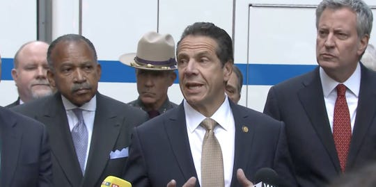 Gov. Andrew Cuomo speaks in New York City about bombs sent to Hillary Clinton and other liberal political figures and the media, including CNN, Wednesday, Oct. 24, 2018. New York City Mayor Bill de Blasio is at right.