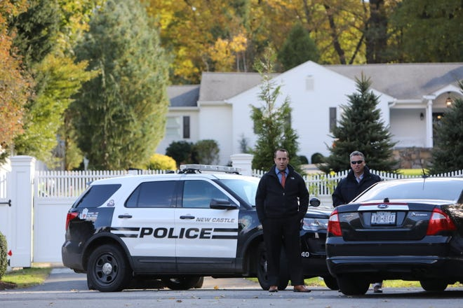 Police are gathered on the street outside Hillary and Bill Clinton's home in Chappaqua after an explosive device sent to Hillary Clinton was intercepted, Wednesday, Oct. 24, 2018.
