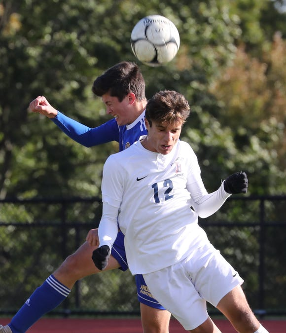 Briarcliff's Justin Duffy, right, goes up for the ball with Ardsley's Bennett Lawrence during their Section 1 Class B boys soccer semifinal at Ardsley Oct. 24, 2018. Briarcliff won 2-1.