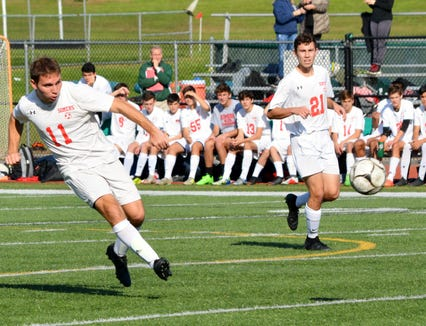 Somers midfielder Jon Riina sends a through ball into the box during the first half of the Tuskers 2-0 win on Monday.
