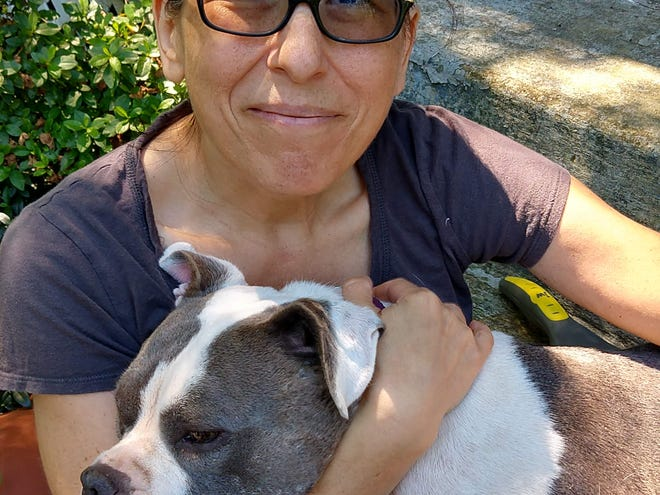 Marianne Sarcich is a breast cancer survivor who lives in North Wilmington with her two daughters, husband and adopted rescue dog, Poppy.