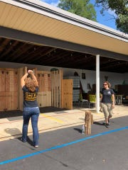 Axes fly at Liquid Alchemy Beverages near Wilmington. A Halloween-themed ax-throwing event will be held there Friday night.