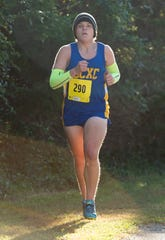 Sussex Central sophomore Tyler Blades competes in a cross country meet against Cape Henlopen, Indian River and Smyrna.  Tyler has lost more than 100 pounds by running.
