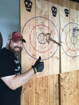 Battle Axe owner Mike Evans at a past ax-throwing event at the Wilmington-area Liquid Alchemy Beverages meadery.