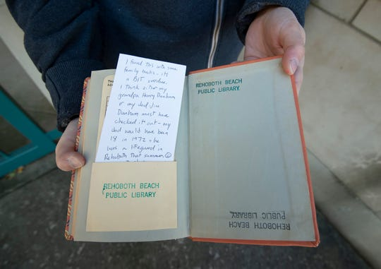 View of a copy of the Adventures of Huckleberry Finn written by Mark Twain and a hand written apology note that was returned to the Rehoboth Beach Public Library after being checked out on July 19, 1972.