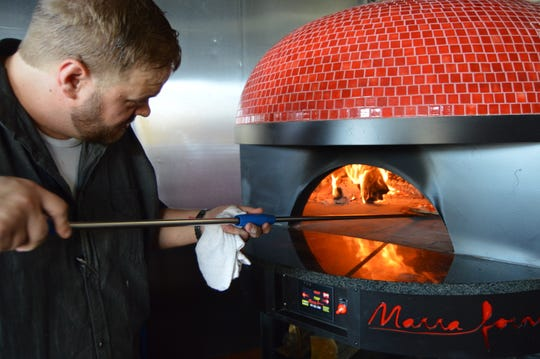 SoDel Concepts is in talks to purchase Brenton Wallace's Crust & Craft pizzeria in Rehoboth Beach.