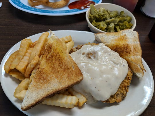 Chicken Fried Steak topped with country gravy served with fries, broccoli and bread at City Cafe in Iowa Park.