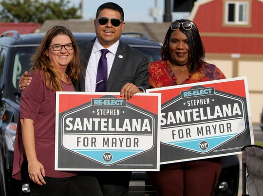 Stephen Santellana campaigns Tuesday, Oct. 23, 2018, outside Home Depot.