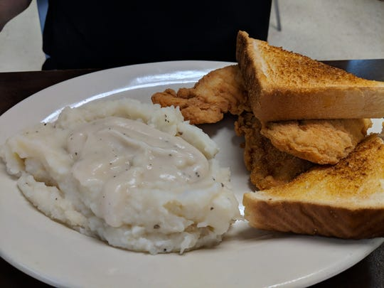 Crispy Chicken Strips served with country gravy, mashed potates and bread at City Cafe in Iowa Park.
