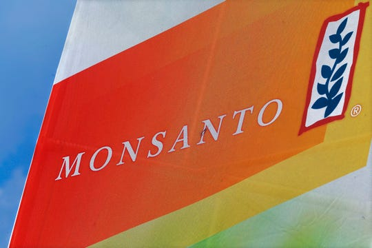FILE - This Aug. 31, 2015 file photo shows the Monsanto logo on display at the Farm Progress Show in Decatur, Ill. After a Northern California judge upheld a jury's verdict that found Monsanto's weed killer caused a groundskeeper's cancer, hundreds of other plaintiffs are wondering what the case might mean for their outstanding claims lawsuits against the agribusiness giant. (AP Photo/Seth Perlman, File)